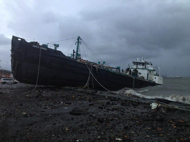 In Staten Island, a record 13 foot storm surge caused the tanker, John B. Caddell, to break free of its morning and run aground in Staten Island. Via Twitter