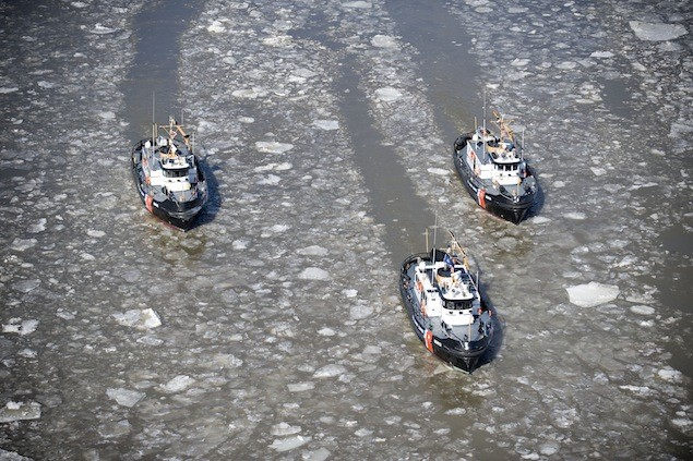 Coast Guard 65-foot harbor tugs (from left) Line, Wire and Hawser steam together on the Hudson River February 21, 2013. Photo: USCG