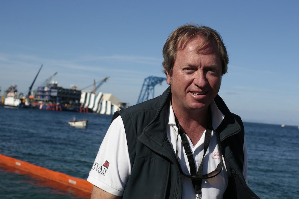 The head of the parbuckling project Nick Sloane poses as Costa Concordia lies on its side next to Giglio Island