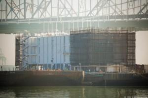The mystery barge at Treasure Island below the SF-Oakland Bay Bridge. Photo credit: James Martin/CNET