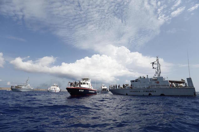 Italian Coast Guard and Guardia di Finanza vessels gather at the spot where 366 migrants perished in the Lampedusa migrant boat disaster, during a commemoration ceremony off the Italian island of Lampedusa October 3, 2014.