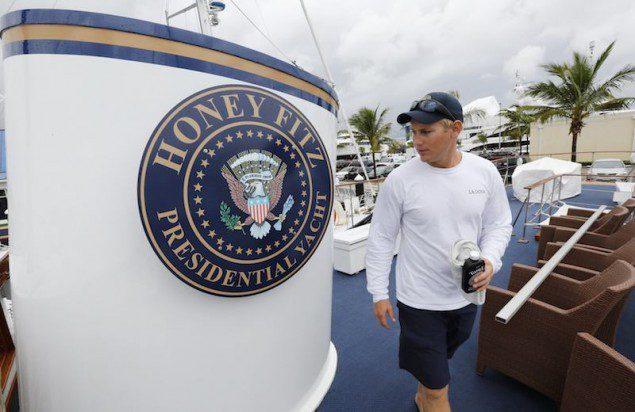 Christopher Hill, a deckhand, walks past a seal on the former presidential yacht, Honey Fitz. REUTERS/Joe Skipper