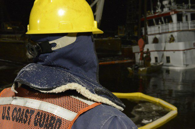 Response crews rig sling to Stephen L. Colby in snowy conditions