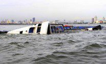 Strong Typhoon Capsizes Ferry in Manila Bay -Photos