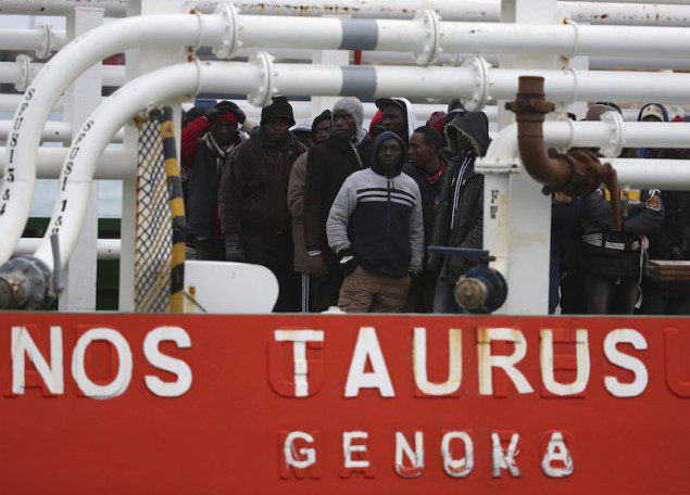 "Migrants arrives by boat ""Nos Taurus Genova"" at the Sicilian harbor of Pozzallo, February 16, 2015. REUTERS Alessandro Bianchi"