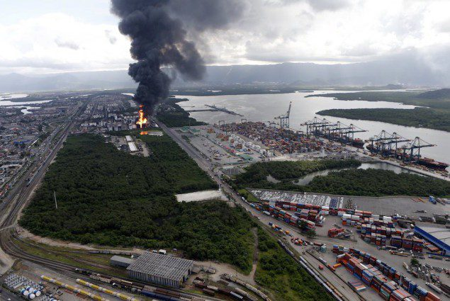 Smoke rises from a fire at a fuel tank storage facility run by Ultracargo in Santos near Sao Paulo April 2, 2015. Eighty firefighters were battling a fire at a fuel tank storage facility run by Ultracargo near Brazil's port of Santos, Latin America's largest, April 2, 2015. REUTERS/Paulo Whitaker