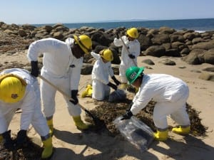 Camarillo CCC members clean up oil at El Capitan State Beach in Santa Barbara County. Photo by Jeremy Day.