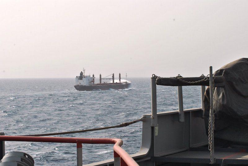 An EUNAVFOR warship escorts a merchant vessel in the Gulf of Aden. Photo: EUNAVFOR