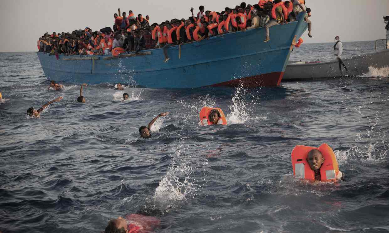 Libya Migrants Swimming From Overcrowded Boat