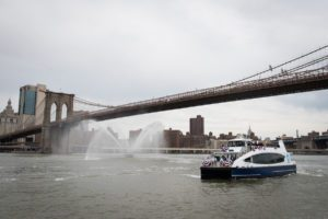 The first NYC Ferry under the brooklyn bridge