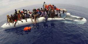 "FILE PHOTO: Migrants on a dinghy are rescued by ""Save the Children"" NGO crew from the ship Vos Hestia in the Mediterranean sea off Libya coast"