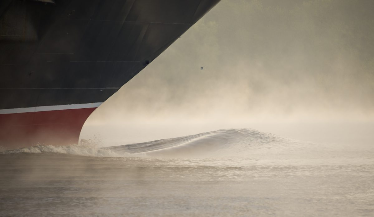 bow wave of a ship in fog