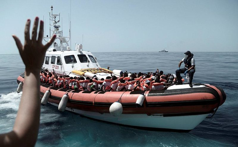 Migrants are seen after being rescued by MV Aquarius in the central Mediterranean Sea