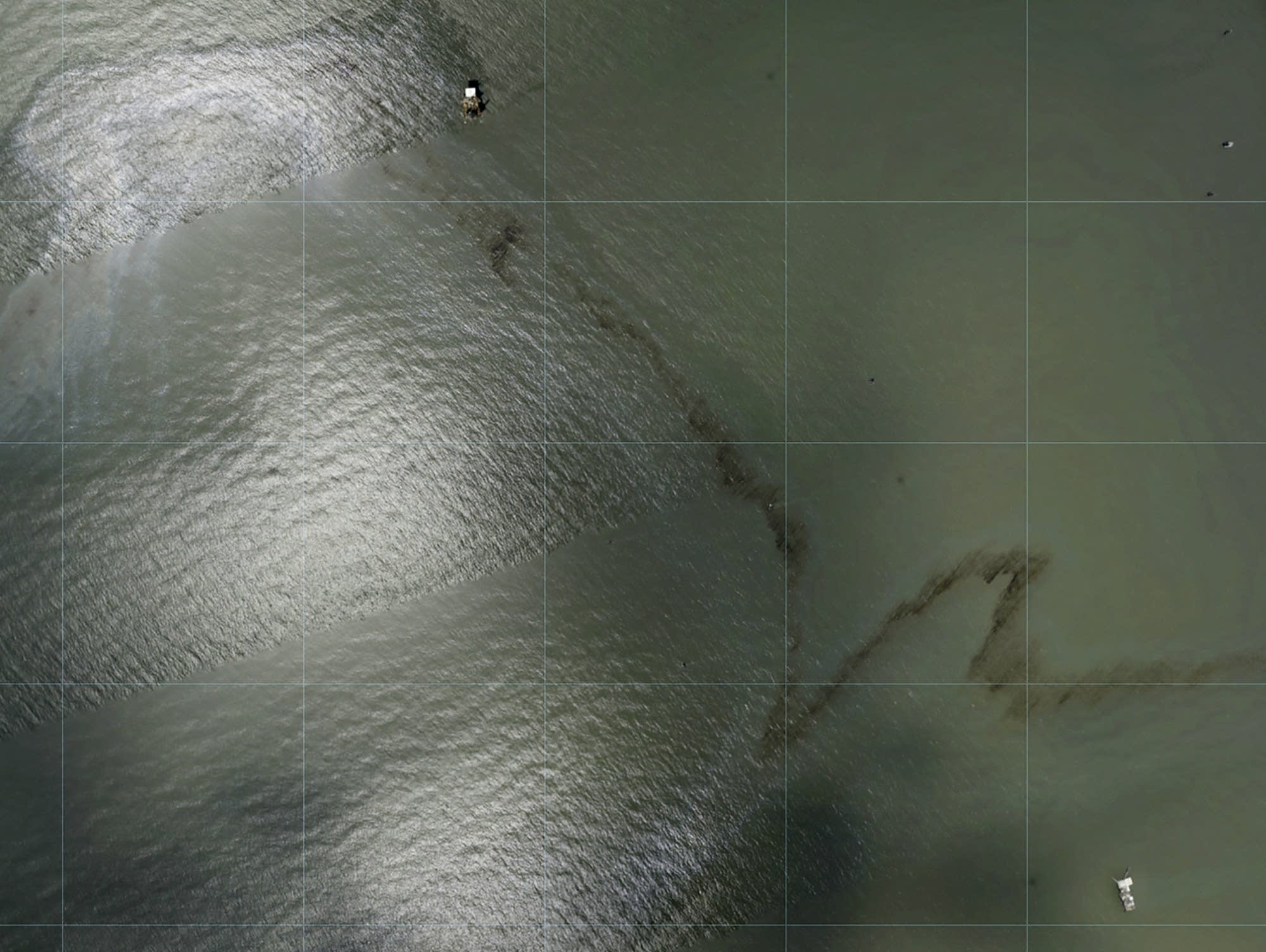 A miles long black slick floating in the Gulf of Mexico near Enterprise Offshore Drilling Rig. Photos via NOAA