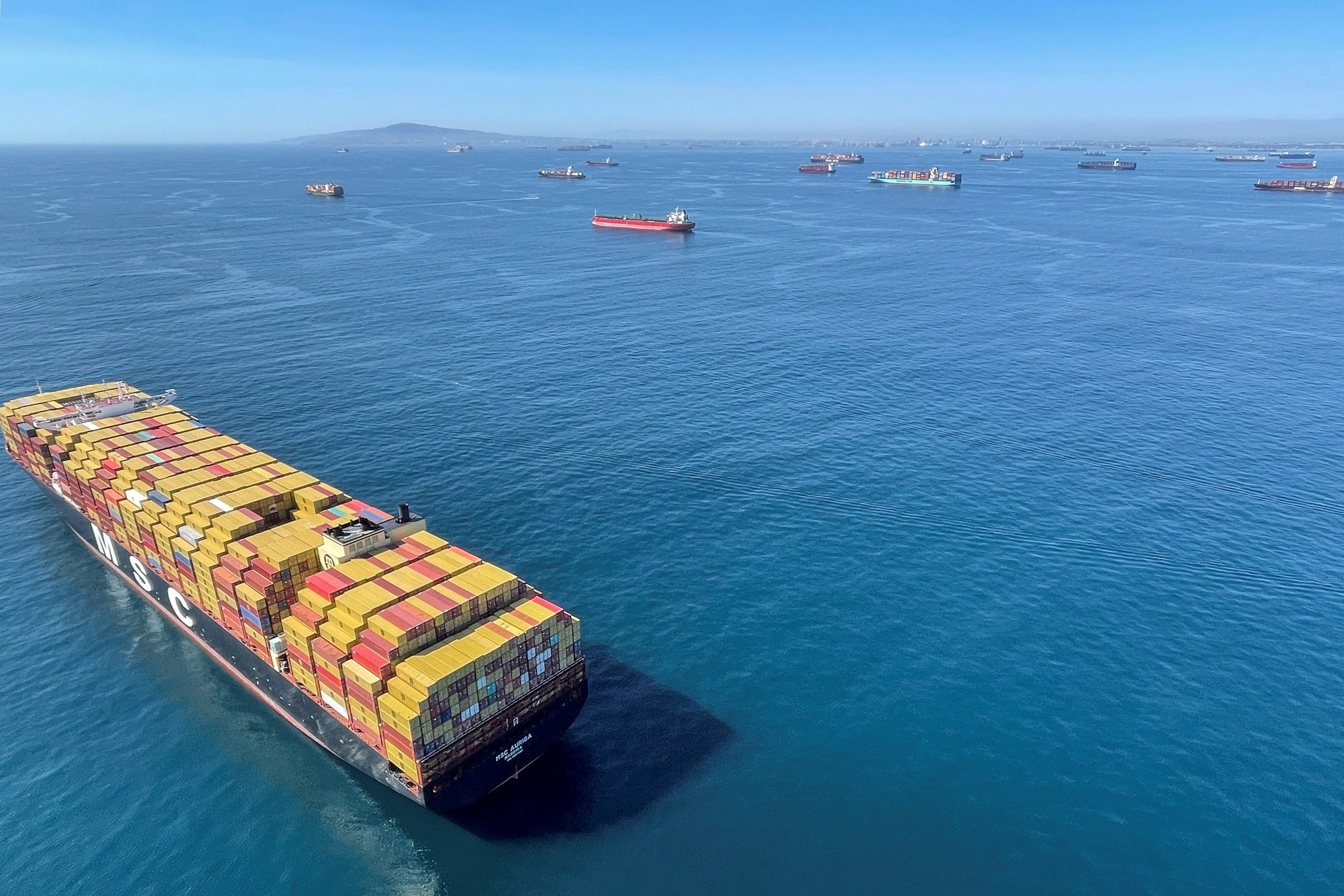 Container ships wait off the coast of the congested Ports of Los Angeles and Long Beach in Long Beach, California
