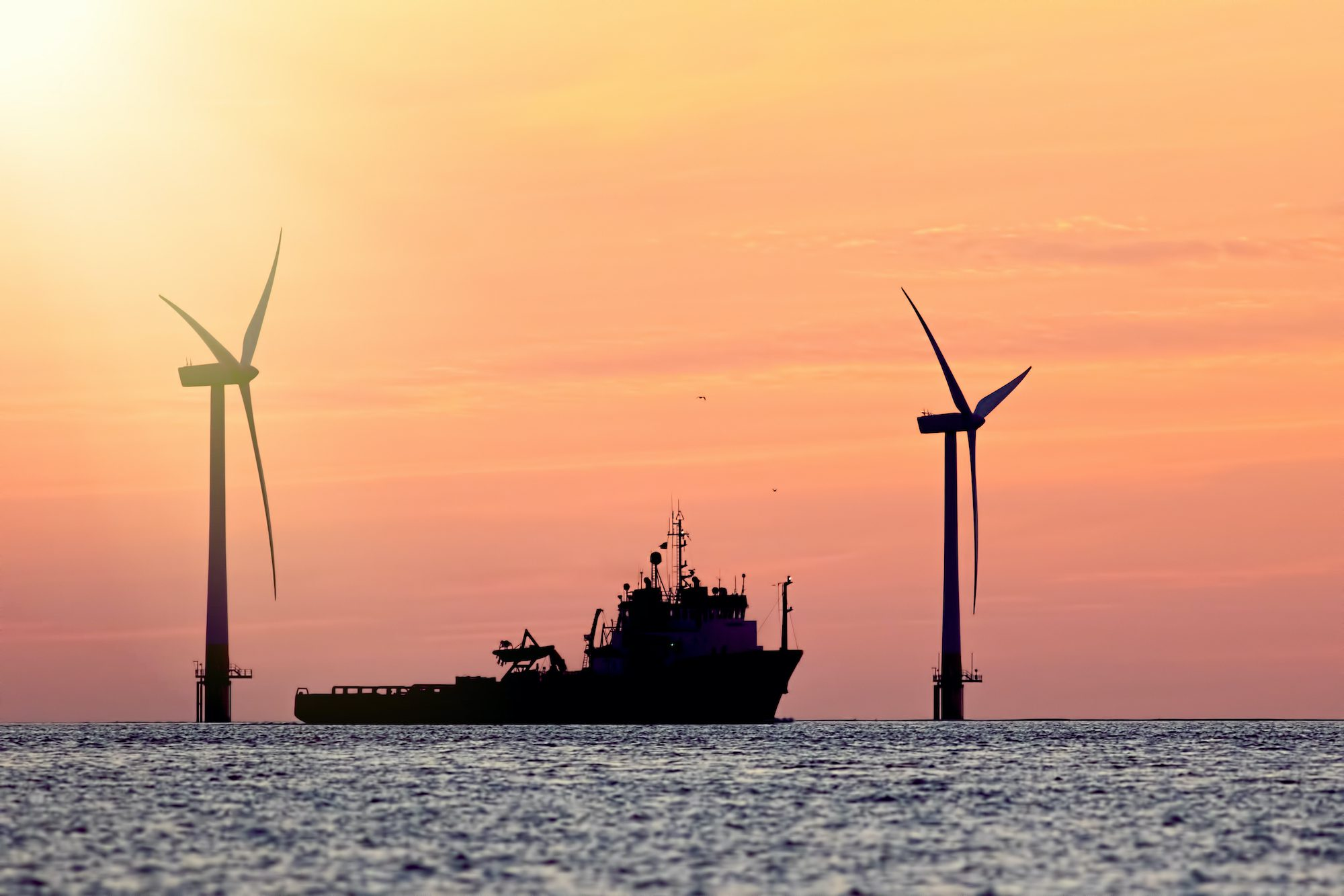 offshore wind farm with vessel in foreground